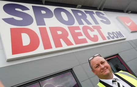 FILE PHOTO: Mike Ashley, founder and majority shareholder of Sports Direct, leads journalists on a factory at the company's headquarters in Shirebrook, Britain