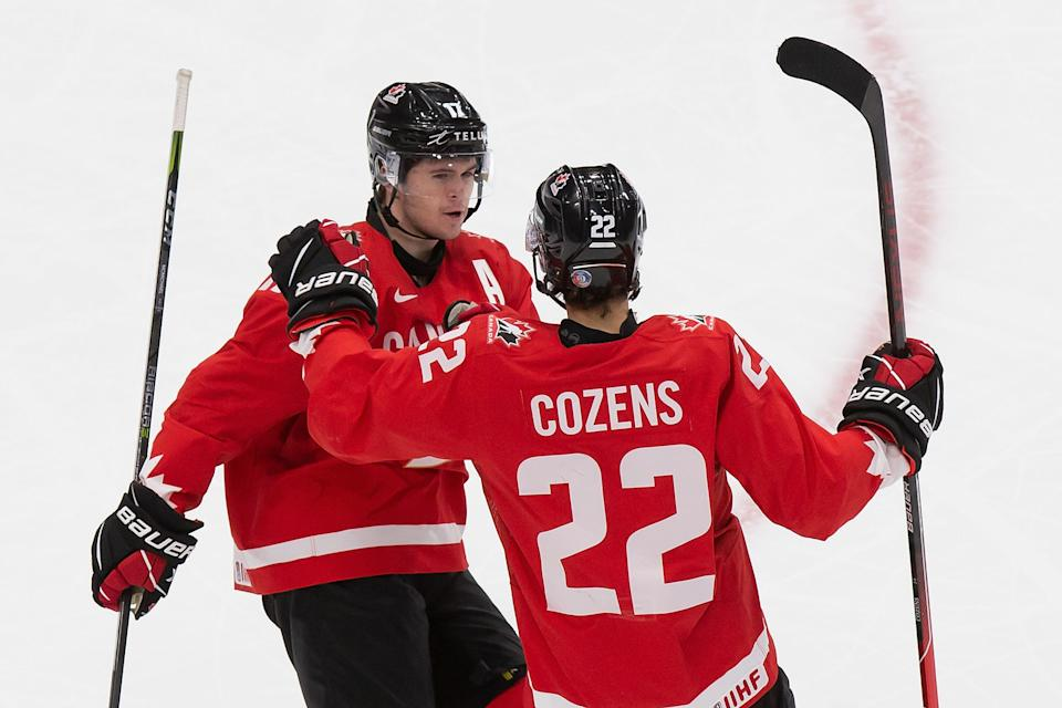 EDMONTON, AB - JANUARY 02: Connor McMichael #17 and Dylan Cozens #22 of Canada celebrate a goal against the Czech Republic during the 2021 IIHF World Junior Championship quarterfinals at Rogers Place on January 2, 2021 in Edmonton, Canada. (Photo by Codie McLachlan/Getty Images)