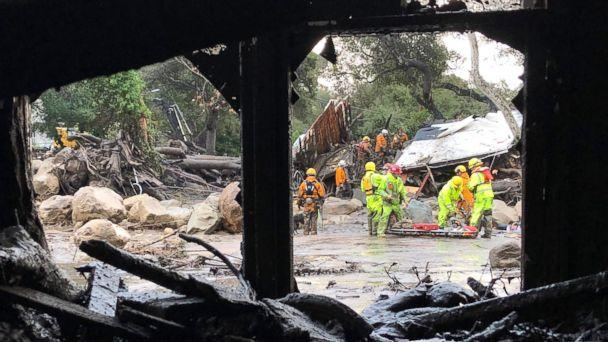 PHOTO: Firefighters search for trapped people in Montecito, Calif, Jan. 9, 2018, after mud and debris destroyed buildings following heavy rains. (@EliasonMike)