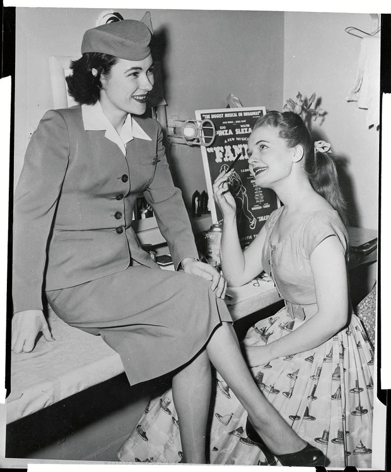 <p>(Original Caption) Backstage at the Majestic Theatre, where the smash hit musical Fanny is playing, Florence Henderson, who plays the title role, in and Henderson, who plays the title role, in and Penny Nolin (left), selected as hostess for the Fanny Show Plane by Pan American World Airways, talk over plans for the First international show plane in theatre history. The Fanny Show Plane arrives in New York from Paris on February 23rd for the performance of Fanny, which is based on Frenchman Marcel Pagnol's three plays about romantic life on the Marseilles waterfront. </p>
