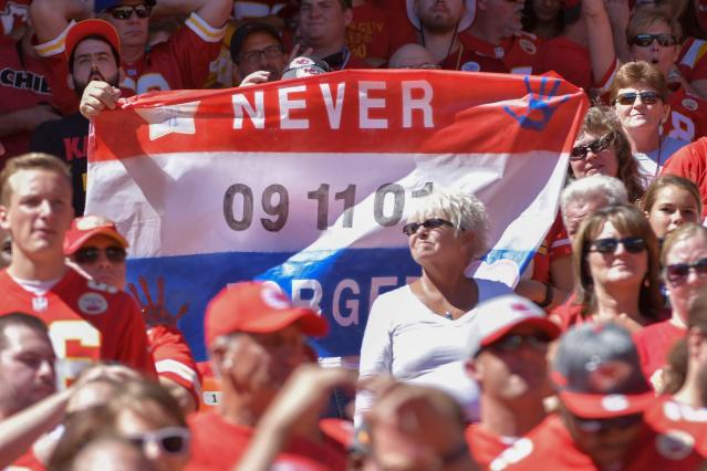 <p>A fan holds up a sign regarding 9/11 during the first half of the game against the San Diego Chargers at Arrowhead Stadium. Mandatory Credit: Denny Medley-USA TODAY Sports </p>