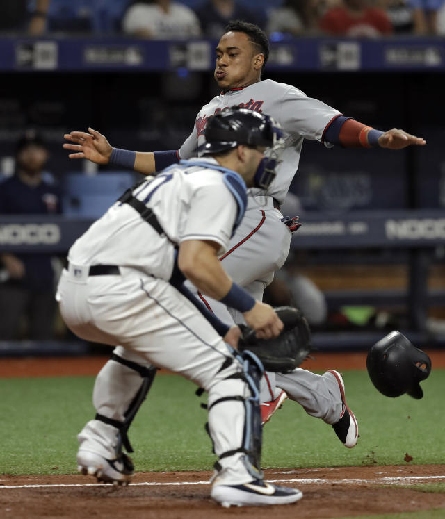 Minnesota Twins' Jorge Polanco, background, scores ahead of the tag by Tampa Bay Rays catcher Mike Zunino on a single by Willians Astudillo during the fifth inning of a baseball game Friday, May 31, 2019, in St. Petersburg, Fla. (AP Photo/Chris O'Meara)