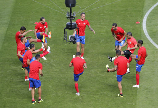 Costa Rica's players warm up prior the group E match between Costa Rica and Serbia at the 2018 soccer World Cup in the Samara Arena in Samara, Russia, Sunday, June 17, 2018. (AP Photo/Vadim Ghirda)