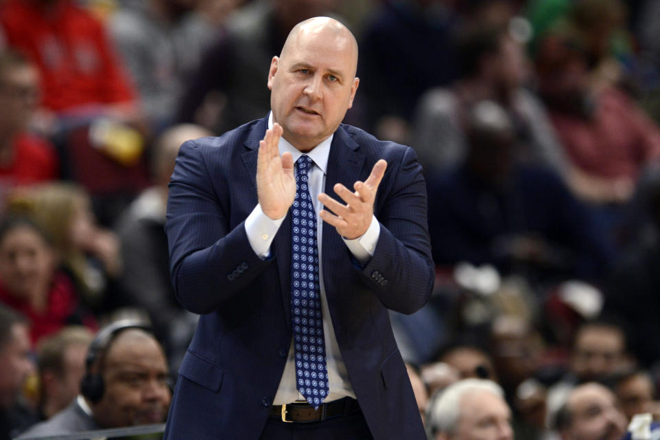 FILE - In this March 10, 2020, file photo, Chicago Bulls coach Jim Boylen cheers on players during the first half of the team's NBA basketball game against the Cleveland Cavaliers in Chicago. Boylen's future is the biggest issue hanging over the Bulls, who were left out when the NBAs Board of Governors approved a 22-team format to restart the pandemic-interrupted season next month in Orlando. (AP Photo/Paul Beaty, File)