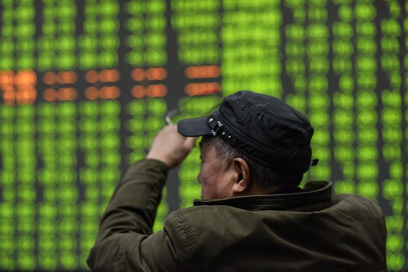 An investor looks at a screen showing stock market movements at a securities company in Hangzhou in China's eastern Zhejiang province on February 3, 2020. - Chinese stocks crashed on February 3 with some major shares quickly falling by the maximum daily limit as the country's investors got their first chance in more than a week to react to the spiralling coronavirus outbreak. (Photo by STR / AFP) / China OUT (Photo by STR/AFP via Getty Images)