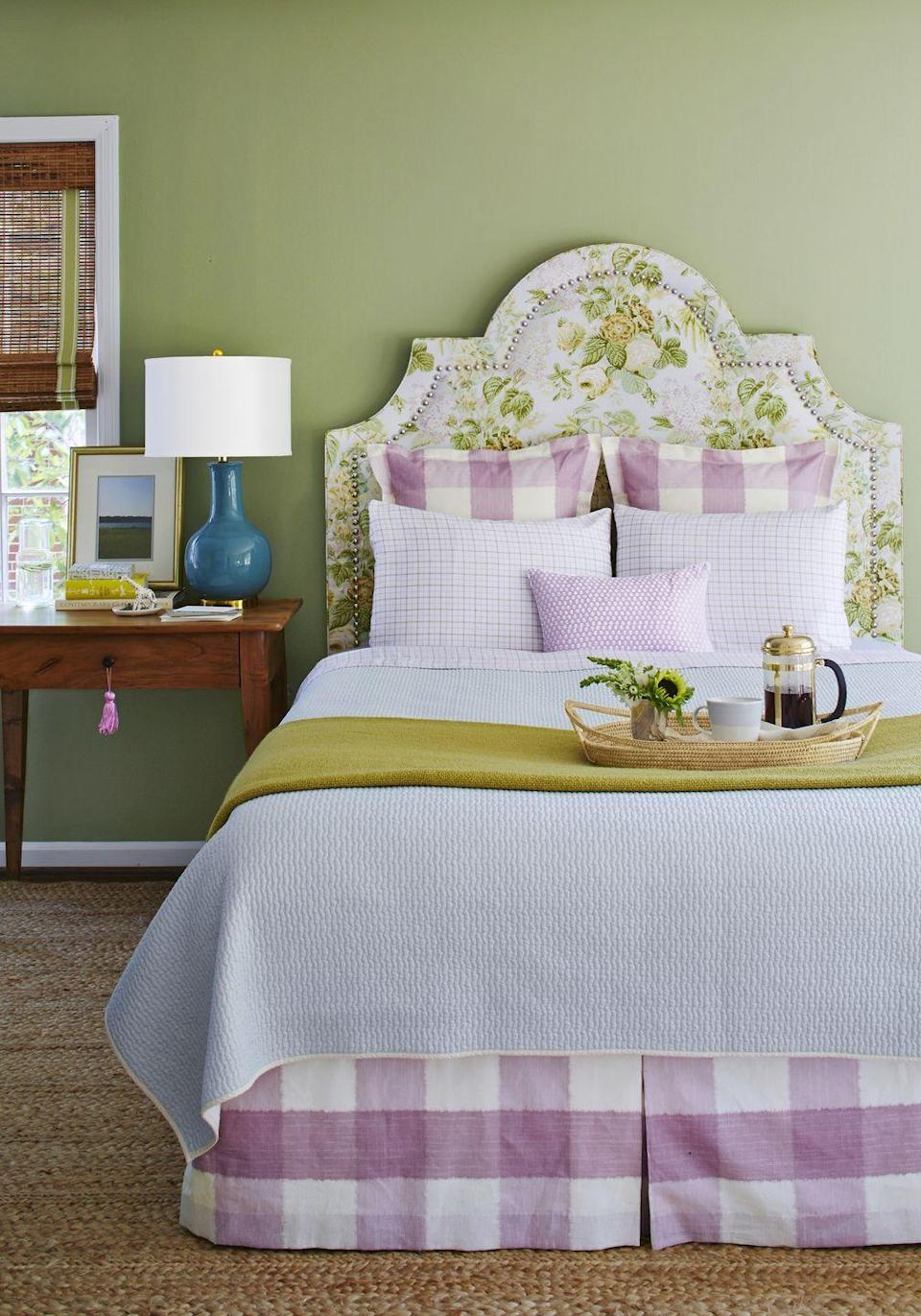 """<p>Nature always provides the best color inspiration. In this pretty, well-appointed bedroom, the wall's rich earthy green color is pulled right from the leafy greens of the headboard's floral fabric. The green hue feels especially feminine when paired with a pretty purple. </p><p><strong>Get the Look: </strong><br>Wall Paint Color: <a href=""""https://go.redirectingat.com?id=74968X1596630&url=https%3A%2F%2Fwww.farrow-ball.com%2Fen-us%2Fpaint-colours%2Folive&sref=https%3A%2F%2Fwww.countryliving.com%2Fremodeling-renovation%2Fhome-makeovers%2Fg32468539%2Fbest-bedroom-paint-colors-ideas%2F"""" rel=""""nofollow noopener"""" target=""""_blank"""" data-ylk=""""slk:Olive by Farrow & Ball"""" class=""""link rapid-noclick-resp"""">Olive by Farrow & Ball</a></p>"""
