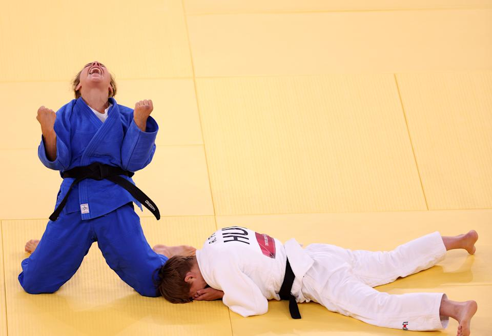 <p>TOKYO, JAPAN - JULY 25: Odette Giuffrida of Team Italy celebrates after defeating Reka Pupp of Team Hungary during the Women's Judo 52kg Contest for Bronze Medal A on day two of the Tokyo 2020 Olympic Games at Nippon Budokan on July 25, 2021 in Tokyo, Japan. (Photo by Harry How/Getty Images)</p>