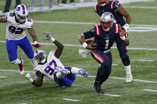 New England Patriots quarterback Cam Newton (1) runs from Buffalo Bills defensive ends Darryl Johnson (92) and Mario Addison (97) on his way to a touchdown in the first half of an NFL football game, Monday, Dec. 28, 2020, in Foxborough, Mass. (AP Photo/Elise Amendola)