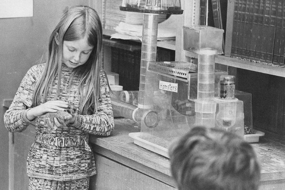 <p>A fifth grade student spends some quality time with the class pet. </p>