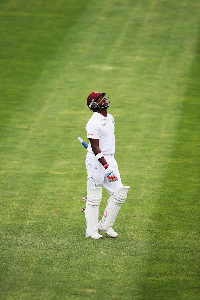 DUNEDIN, NEW ZEALAND - DECEMBER 07: Darren Bravo of the West Indies walks off after being dismissed by Trent Boult of New Zealand during day five of the first test match between New Zealand and the West Indies at University Oval on December 7, 2013 in Dunedin, New Zealand. (Photo by Hannah Johnston/Getty Images)