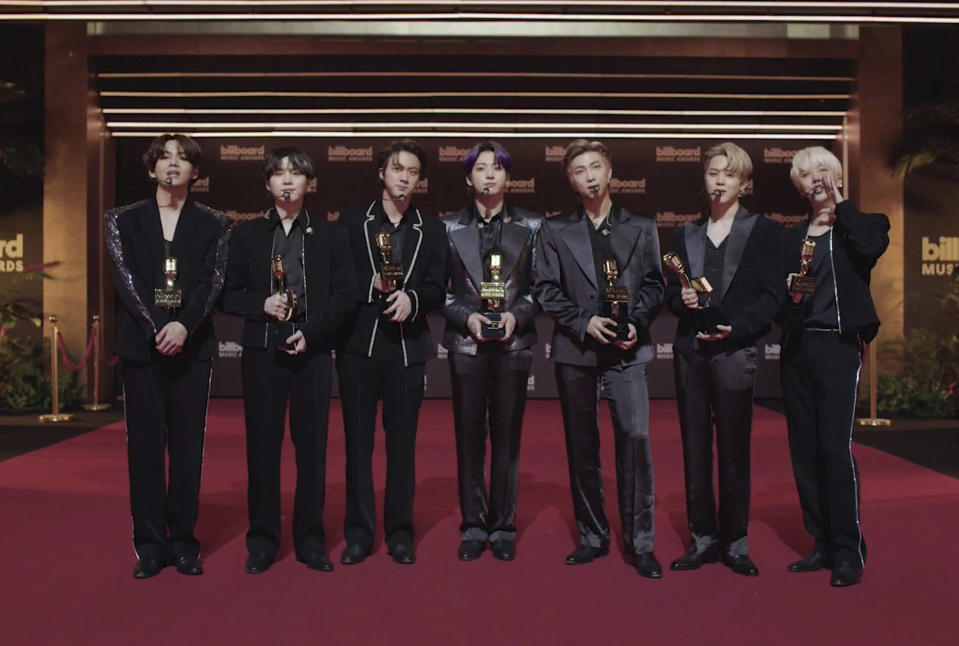 """In this video image provided by NBC, BTS accepts the top selling song award for """"Dynamite"""" during the Billboard Music Awards on Sunday, May 23, 2021. (NBC via AP)"""