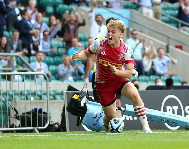 Louis Lynagh scored two late tries to seal Harlequins' first league title in nine years