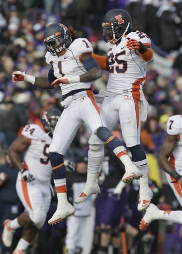 Illinois defensive back Terry Hawthorne (1) and Ashante Williams (25) celebrate after Hawthorne intercepted a pass during the first half of an NCAA college football game against Northwestern in Evanston, Ill., Saturday, Nov. 24, 2012. (AP Photo/Nam Y. Huh)