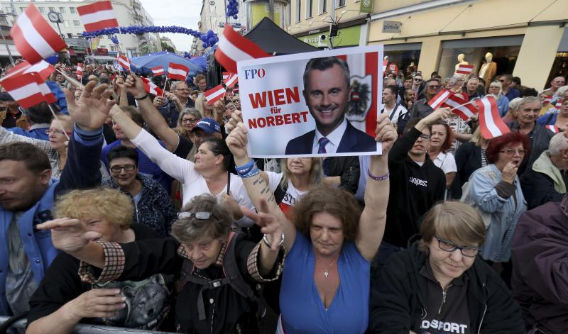 Supporters wave with a poster of Norbert Hofer leader of the right-wing Freedom Party, FPOE, slogan reads: 'Vienna for Hofer' at a closing rally ahead of elections in Vienna, Austria, Thursday, Sept. 27, 2019. The Austrian elections will held on Sunday, Sept. 29, 2019. (AP Photo/Ronald Zak)