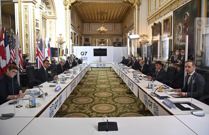 Foreign Ministers are seated prior to a G7 foreign ministers meeting in London, Wednesday, May 5, 2021. Diplomats from the group of wealthy nations are meeting in London for their first face-to-face gathering in two years. (Ben Stansall/Pool Photo via AP)