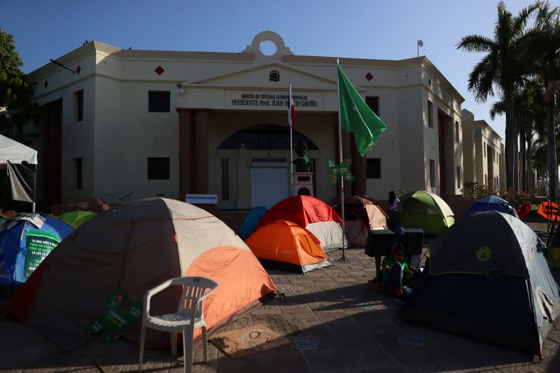 Tents of abortion rights activists are set up in front of the National Palace during a protest to pressure parliament over a proposed reform to the penal code that could end the total ban on abortion, in Santo Domingo