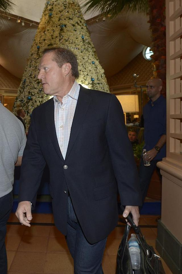 CORRECTS SPELLING OF LAST NAME TO BORAS - Player agent Scott Boras, left, walks to an interview at baseball's winter meetings in Lake Buena Vista, Fla., Wednesday, Dec. 11, 2013.(AP Photo/Phelan M. Ebenhack)