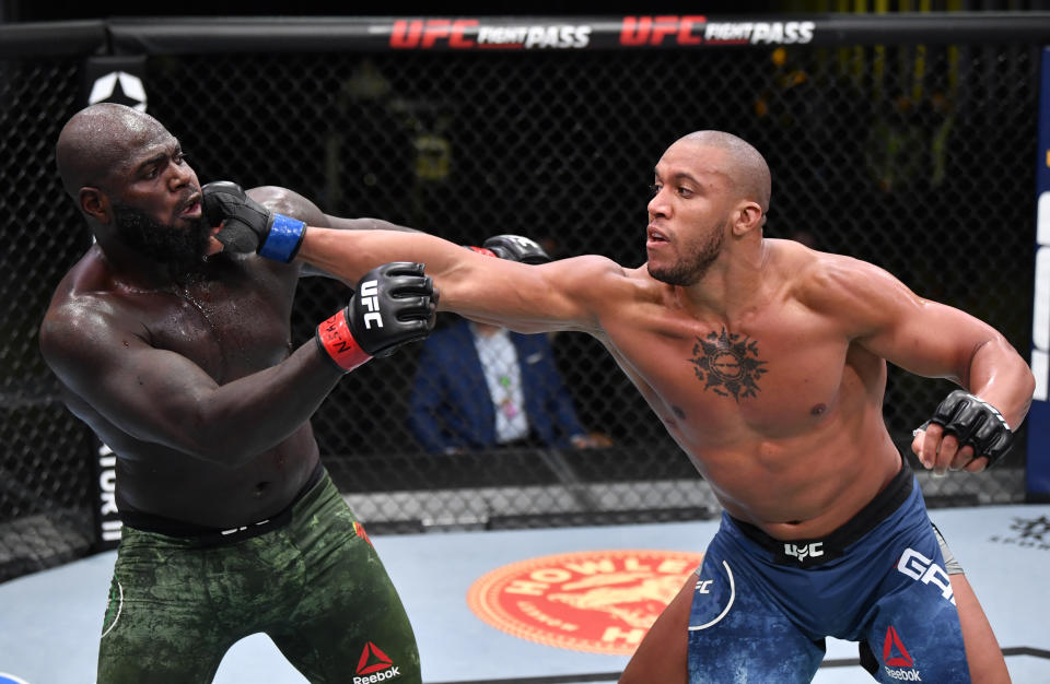 LAS VEGAS, NEVADA - FEBRUARY 27: (R-L) Ciryl Gane of France punches Jairzinho Rozenstruik of Suriname in a heavyweight bout during the UFC Fight Night event at UFC APEX on February 27, 2021 in Las Vegas, Nevada. (Photo by Jeff Bottari/Zuffa LLC)