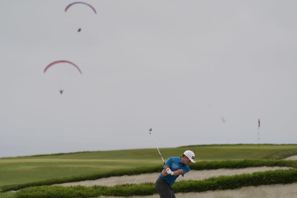 Mackenzie Hughes, of Canada, hits from the sand trap on the fourth fairway during the final round of the U.S. Open Golf Championship, Sunday, June 20, 2021, at Torrey Pines Golf Course in San Diego. (AP Photo/Gregory Bull)