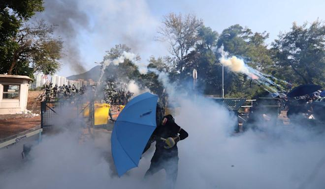 Riot police on Monday fire tear gas on Chinese University campus. Photo: Felix Wong