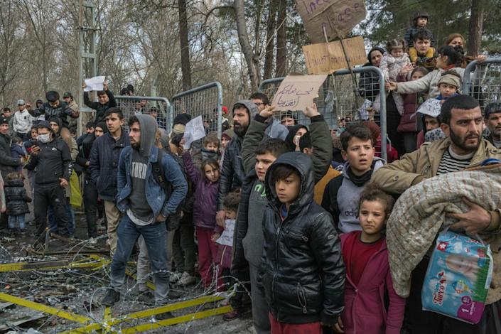 Hundreds of migrants gather by Turkey's Pazarkule border crossing with Greece, near Edirne, northwestern Turkey, on March 5, 2020. (The New York Times)