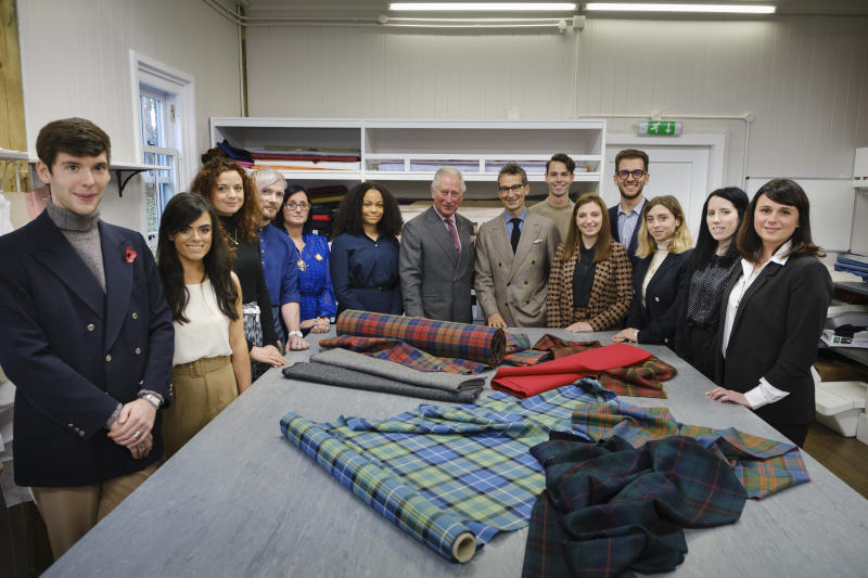 Prince Charles is pictured with Yoox Net-A-Porter chairman Federico Marchetti and students during a visit to Dumfries House in Ayrshire, Scotland, to launch a project for trainee artisans. [Photo: Getty]