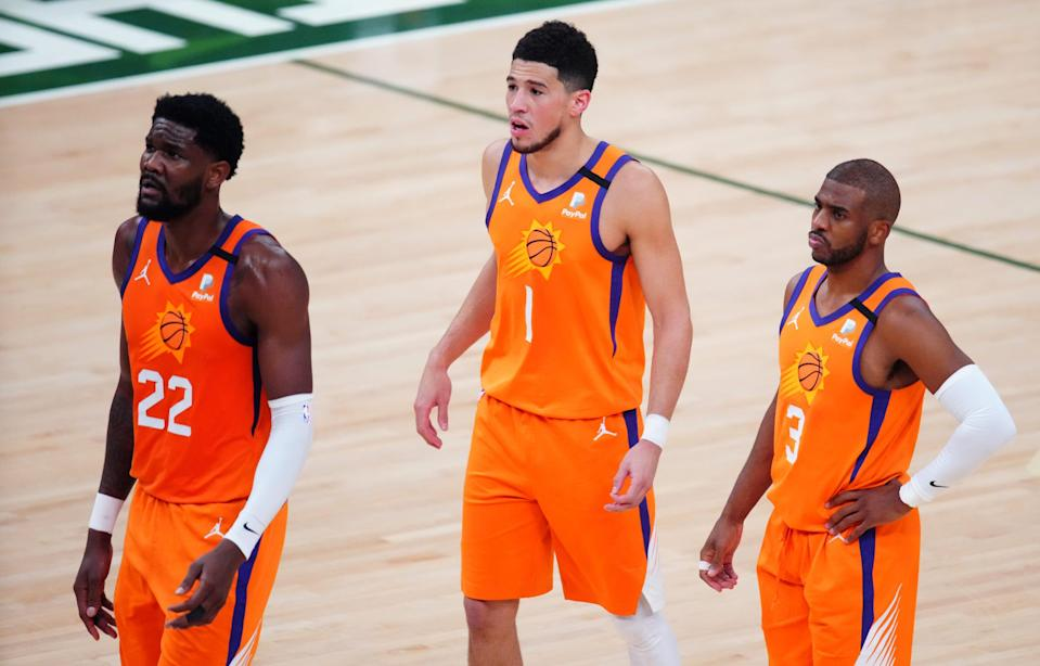 """Deandre Ayton (22), Devin Booker (1) and Chris Paul lost in the first NBA Finals appearance for each of them. But Suns coach Monty Williams said, """"Now we know what it takes to get here."""""""