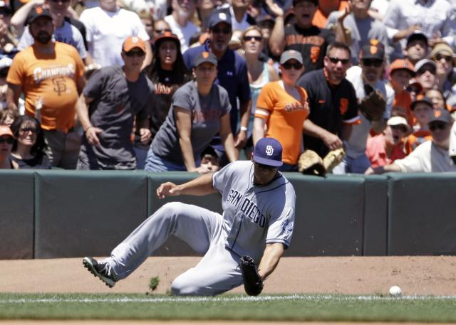 San Diego Padres right fielder Kyle Blanks misses a fly ball hit by San Francisco Giants' Brandon Belt during the fourth inning of their baseball game on Wednesday, June 19, 2013 in San Francisco. Giants' Hunter Pence scored a run on the play. (AP Photo/Eric Risberg)
