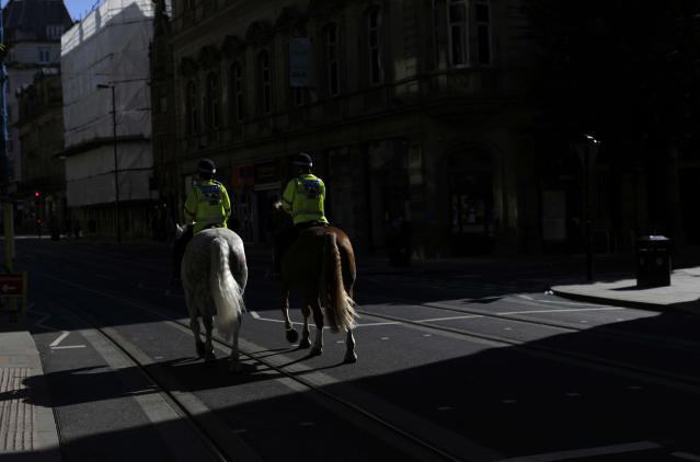 <p>Mounted police officers on patrol in Manchester, England, Tuesday May 23, 2017, the day after the suicide attack at an Ariana Grande concert that left 22 people dead as it ended on Monday night. (AP Photo/Emilio Morenatti) </p>