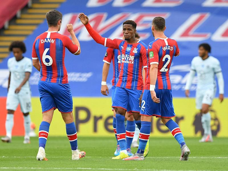 Zaha celebrates after his scorching strike halves the deficit: Getty