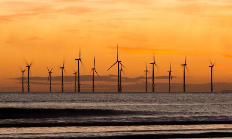 Sunrise from Seaton Carew beach near Hartlepool with Teesside offshore wind farm in distance.