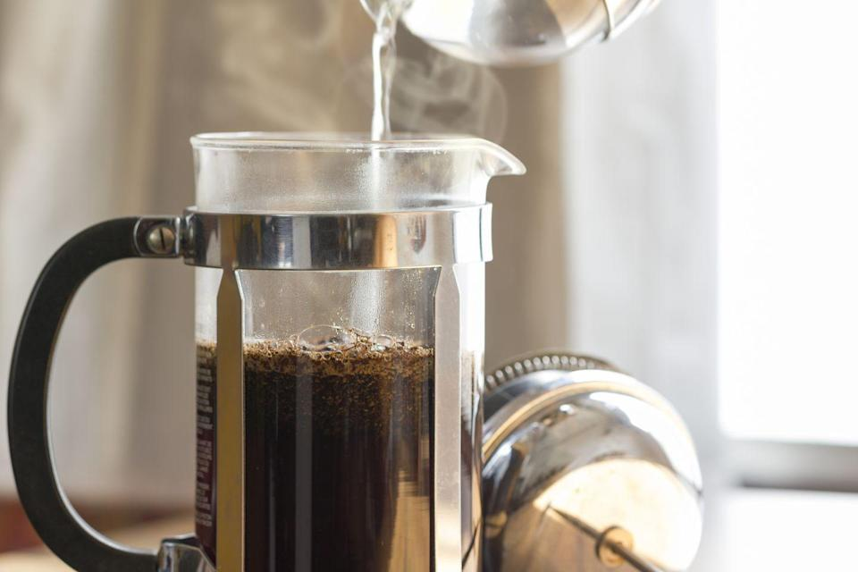 """<p>There's a slew of studies that link the antioxidants and caffeine found in unsweetened tea and coffee to <a href=""""https://www.goodhousekeeping.com/health/diet-nutrition/a32231/healthy-benefits-of-coffee/"""" rel=""""nofollow noopener"""" target=""""_blank"""" data-ylk=""""slk:health benefits"""" class=""""link rapid-noclick-resp"""">health benefits</a>, including decreased risk of chronic disease and weight management. Black coffee or tea is always a zero-calorie choice. My pro tip: Drink 16 ounces of water or unsweetened tea or coffee before you head out the door in the morning. This will help you get a head start on your hydration goals for the day and ensure you're making up for overnight losses. <br></p>"""