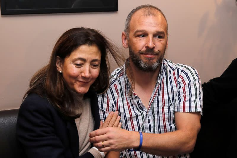 Kidnapped French aid worker's son cautious on word of her release in Mali