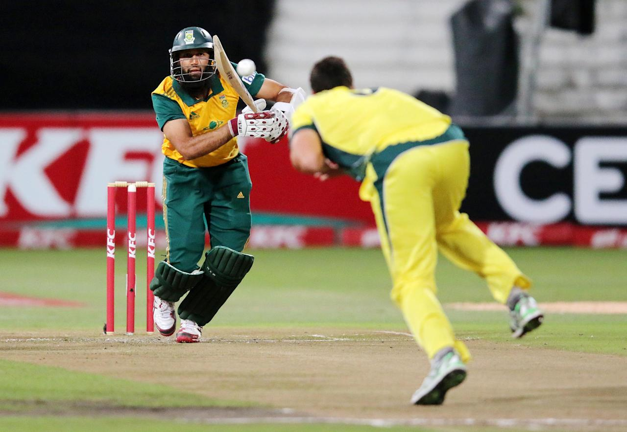 DURBAN, SOUTH AFRICA - MARCH 12: Hashim Amla of South Africa is caught and bowled by Nathan Coulter-Nile of Australia during the 2nd T20 International match between South Africa and Australia at Sahara Stadium Kingsmead on March 12, 2014 in Durban, South Africa. (Photo by Anesh Debiky/Gallo Images/Getty Images)