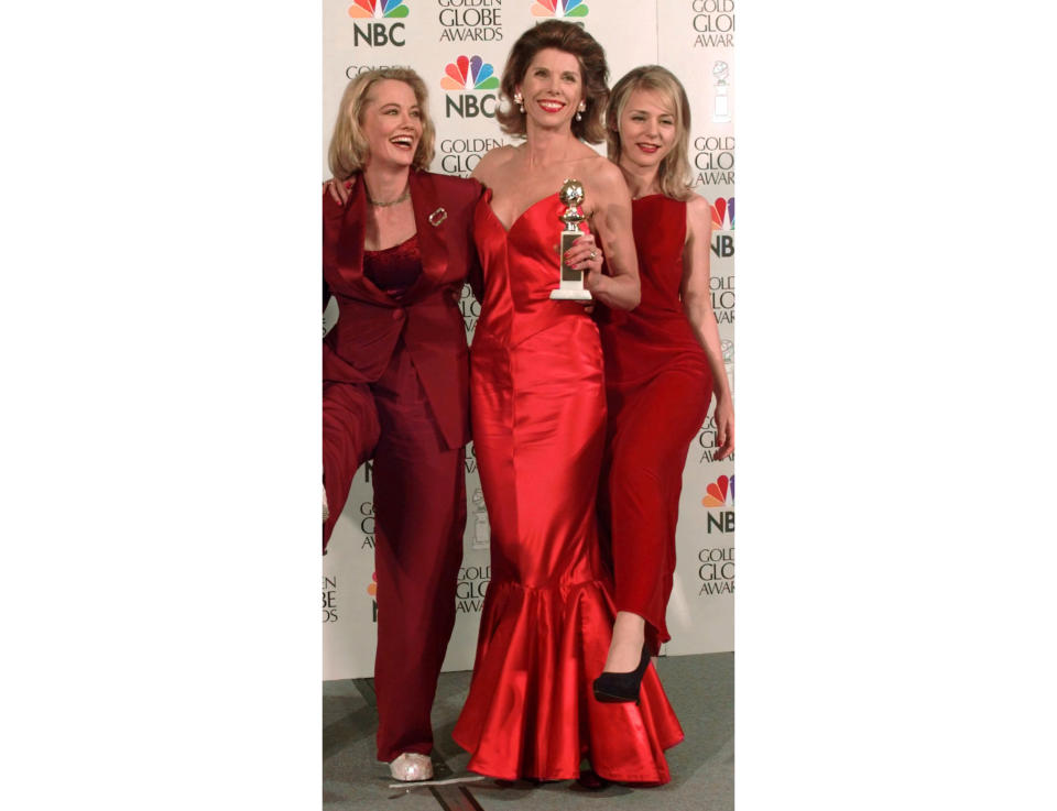 """FILE - Cast members from """"Cybill,"""" from left, Cybill Shepherd, Christine Baranski and DeeDee Pfeiffer appear at the Golden Globe Awards in Beverly Hills, Calif. on Jan. 21, 1996. The show won best television series, music or comedy. The Bob Mackie gown Baranski wore to the awards show is among the items being auctioned for an online charity auction on Wednesday. (AP Photo/Mark J. Terrill, File)"""