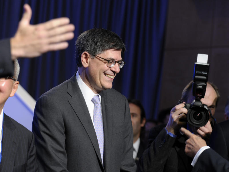 Treasury Secretary Jacob Lew waits to pose with the Group of 20, Friday, Oct. 11, 2013, at the International Monetary Fund (IMF) headquarters in Washington. Finance ministers and central bank officials from the Group of 20 nations are in Washington ahead of weekend meetings of the 188-nation International Monetary Fund and its sister lending organization, the World Bank. (AP Photo/Susan Walsh)
