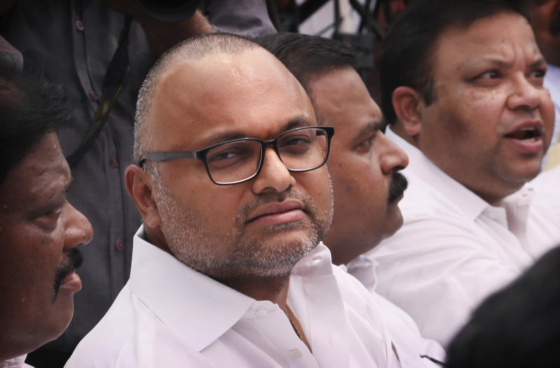 Karti Chidambaram, son of former Indian Finance Minister Palaniappan Chidambaram, participates in an an all party protest against the revocation of Kashmir's special constitutional status from Indian state of Jammu and Kashmir, in New Delhi, India, Thursday, Aug. 22, 2019. Karti Chidambaram has already been named as a defendant in the money-laundering case involving 3 billion rupees ($43 million). His father Palaniappan Chidambaram has already been arrested in the case. (AP Photo/Manish Swarup)