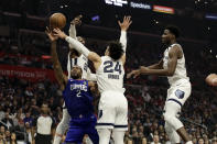 Los Angeles Clippers' Kawhi Leonard (2) drive to the basket as Memphis Grizzlies' Jae Crowder, top left, Dillon Brooks (24) Jaren Jackson Jr., right, defend during the first half of an NBA basketball game Saturday, Jan. 4, 2020, in Los Angeles. (AP Photo/Marcio Jose Sanchez)