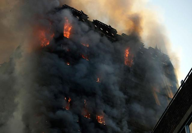 <p>Smoke and flames rise from a building on fire in London, Wednesday, June 14, 2017. (Matt Dunham/AP) </p>