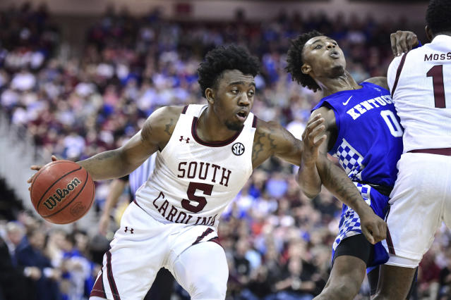 South Carolina guard Jermaine Couisnard (5) dribbles the ball as T.J. Moss (1) sets a screen on Kentucky guard Ashton Hagans (0) during the second half an NCAA college basketball game Wednesday, Jan. 15, 2020, in Columbia, S.C. South Carolina won 81-78. (AP Photo/Sean Rayford)