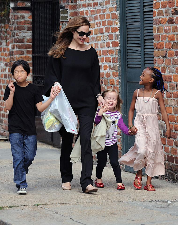 Angelina Jolie took three of her six children (Pax, 8, Vivienne, 3, and  Zahara, 7) out for a snack run in New Orleans on Sunday. The family has  been in the Big Easy to attend the annual Make It Right gala, which Brad  Pitt co-hosted with Ellen DeGeneres. The foundation benefits the  survivors of Hurricane Katrina. (3/11/2012)