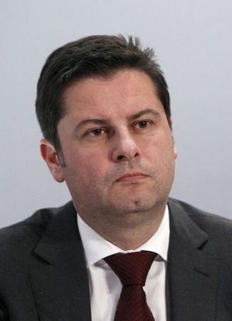 CEO of the German Soccer Federation Seifert listens during a news conference after DFL meeting in Frankfurt
