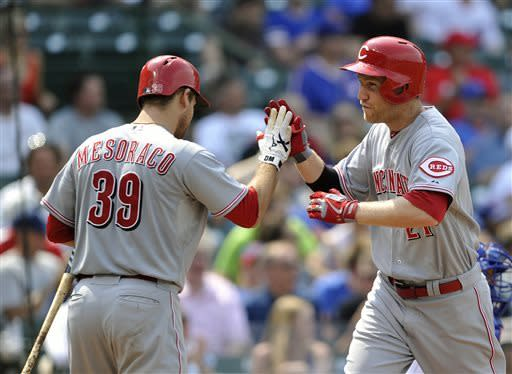 Cincinnati Reds' Devin Mesoraco (39) congratulates Todd Frazier after his solo home run against the Chicago Cubs during the seventh inning of a baseball game on Wednesday, June 12, 2013, in Chicago. (AP Photo/Jim Prisching)