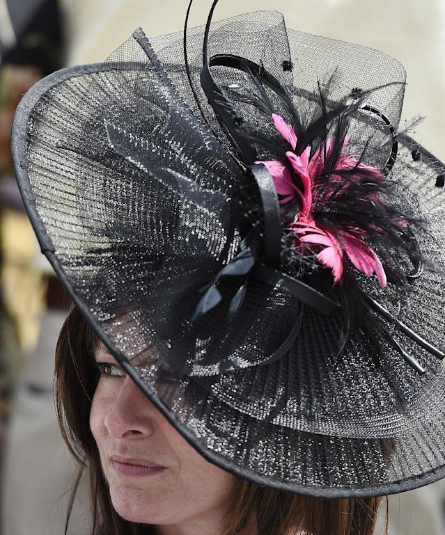 Donna Mitchell, of Pittsburgh, Pa., watches the infield before the 139th Preakness Stakes horse race at Pimlico Race Course, Saturday, May 17, 2014, in Baltimore. (AP Photo/Nick Wass)