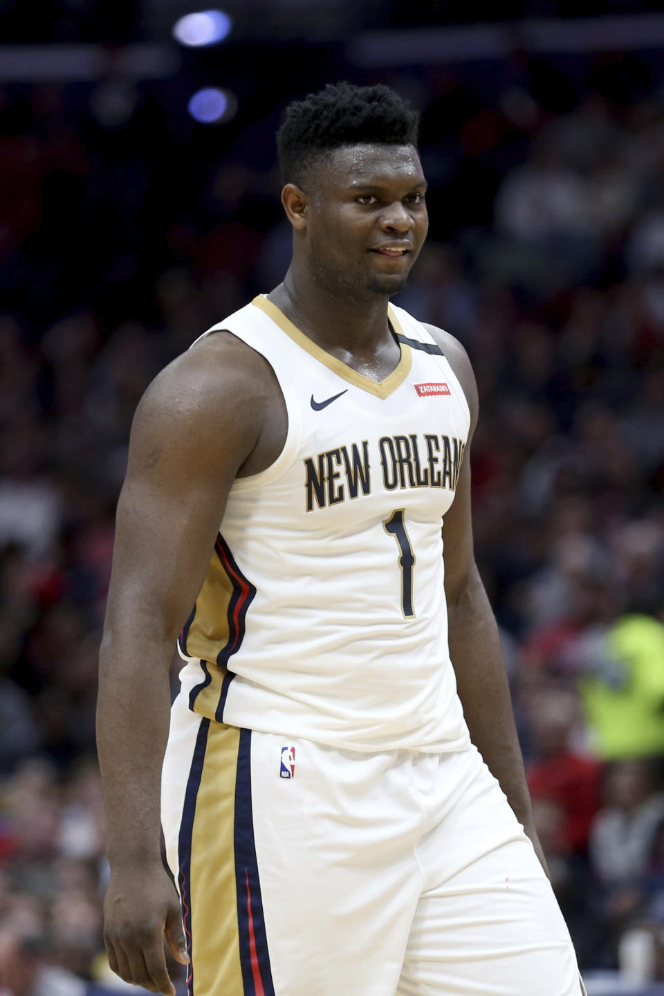 New Orleans Pelicans forward Zion Williamson (1) waits to shoot a free thrown in the second half of an NBA basketball game in New Orleans, Sunday, March 1, 2020. (AP Photo/Rusty Costanza)