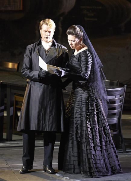 """In this March 2, 2013 photo provided by the Vienna State Opera Toby Spence in the role of Don Ottavio and Marina Rebeka as Donna Anna perform during a dress rehearsal for Wolfgang Amadeus Mozart's opera """"Don Giovanni"""" at the state opera in Vienna, Austria. (AP Photo/Vienna State Opera, Michael Poehn)"""