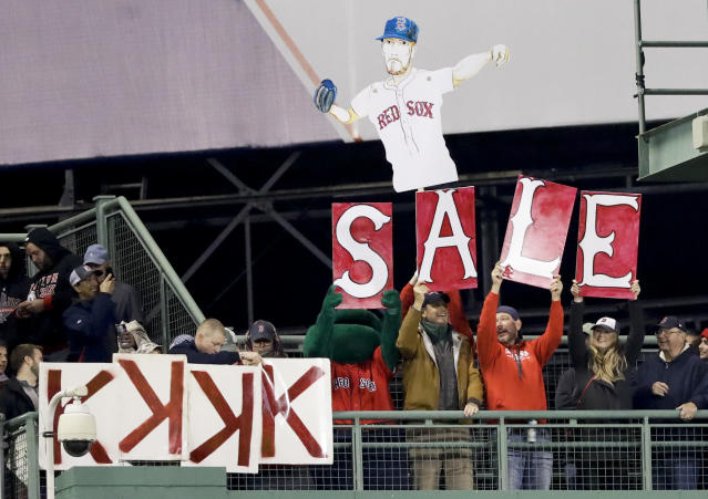 Fans cheer for Boston Red Sox starting pitcher Chris Sale during the fourth inning in Game 1 of a baseball American League Championship Series against the Houston Astros on Saturday, Oct. 13, 2018, in Boston. (AP Photo/David J. Phillip)