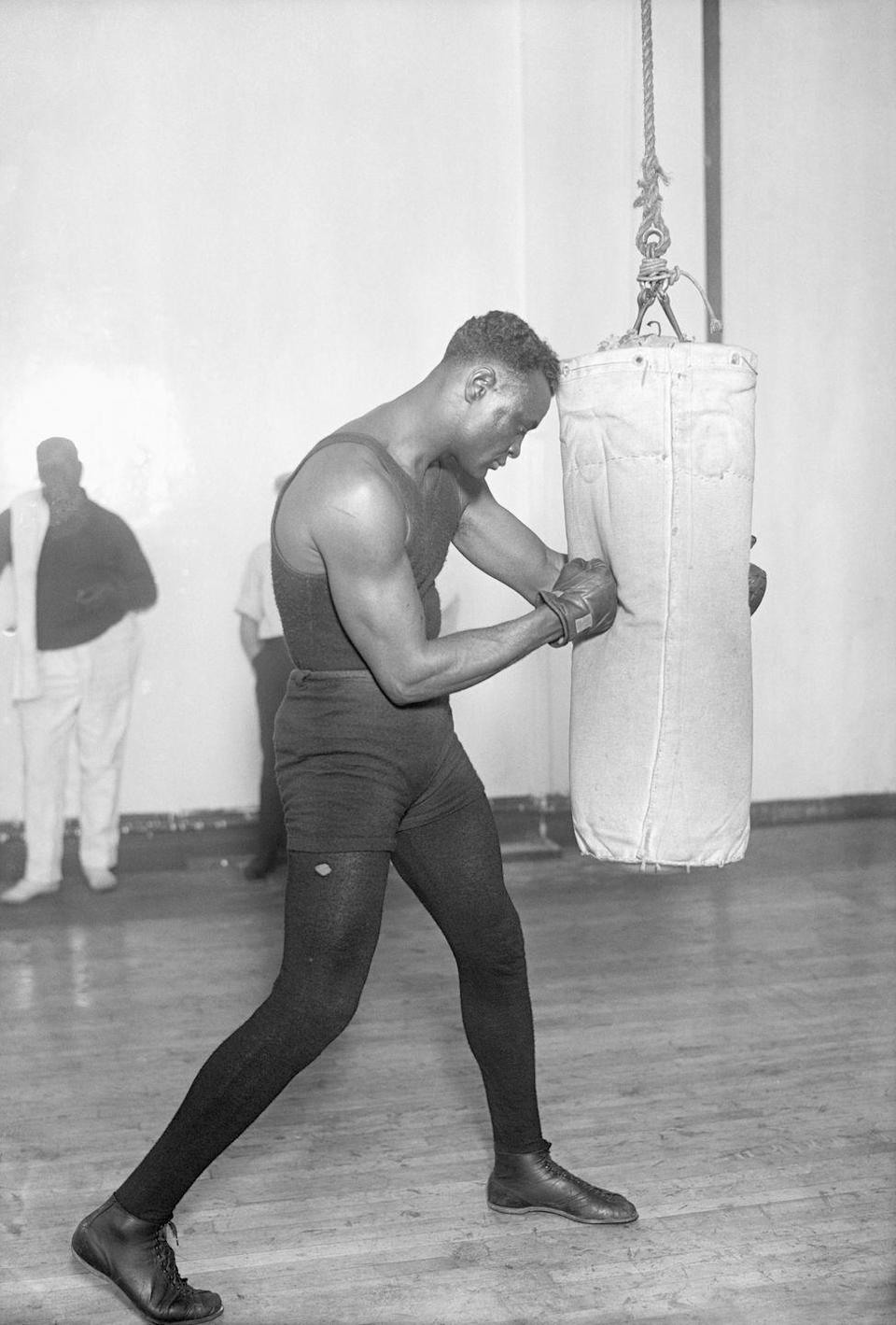 <p>Boxing was a huge and popular sport in America in the 1920s. This is a photo of Harry Wills training at Grupp's Gym for a big match. </p>