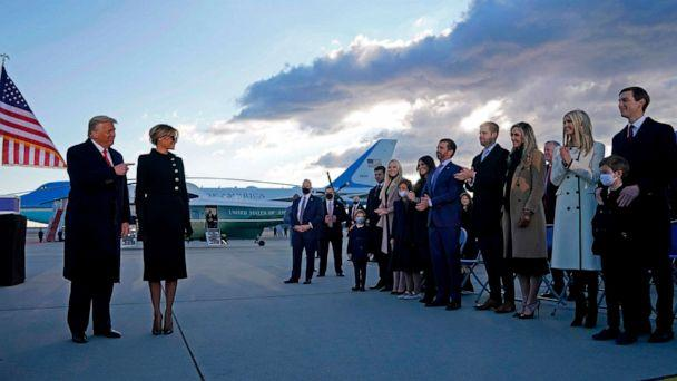 PHOTO: President Donald Trump and First Lady Melania are greeted by their family members on the tarmac at Joint Base Andrews in Maryland, Jan. 20, 2021, after departing the White House. (Alex Edelman/AFP via Getty Images)