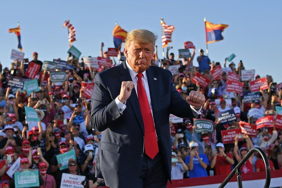 "US President Donald Trump dances as he leaves a rally at Tucson International Airport in Tucson, Arizona on October 19, 2020. - US President Donald Trump went after top government scientist Anthony Fauci in a call with campaign staffers on October 19, 2020, suggesting the hugely respected and popular doctor was an ""idiot."" (Photo by MANDEL NGAN / AFP) (Photo by MANDEL NGAN/AFP via Getty Images)"